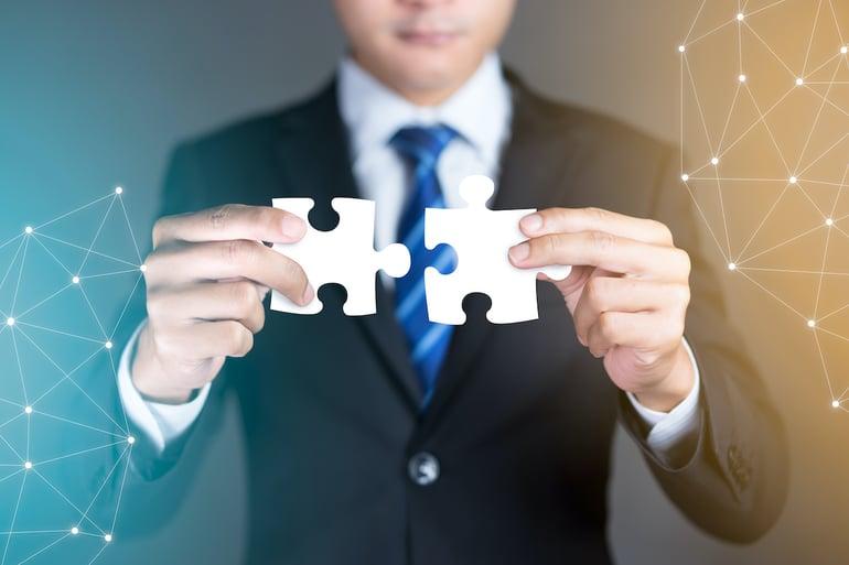 Person merging puzzle pieces